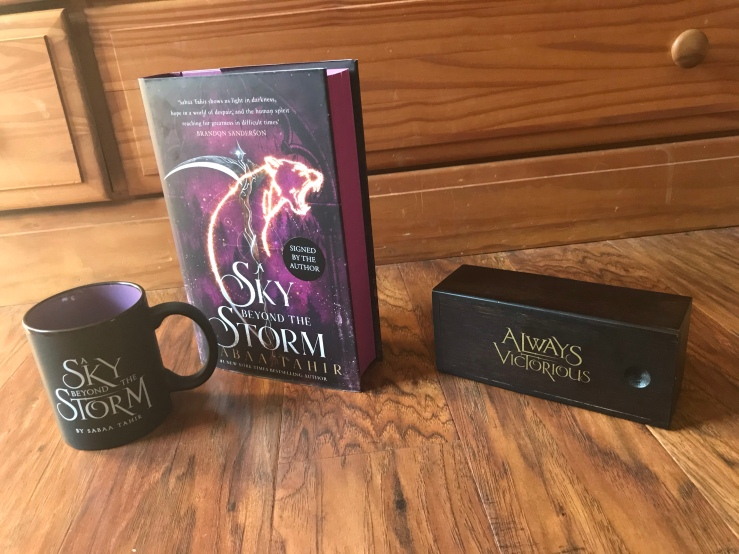 A Sky Beyond the Storm hardback, mug, and wooden box