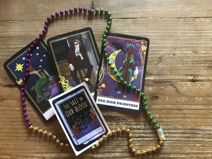 Salt in our Blood tarot cards x3, mardi gras beads, bookplate sticker
