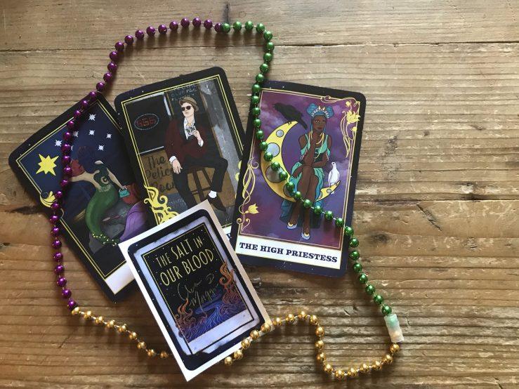 Salt in our Blood tarot cards x3, mardi gras beads, bookplate sticker